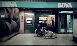 Impossible to ignore. A homeless person sleeping in front of one of Spain's most profitable banks.